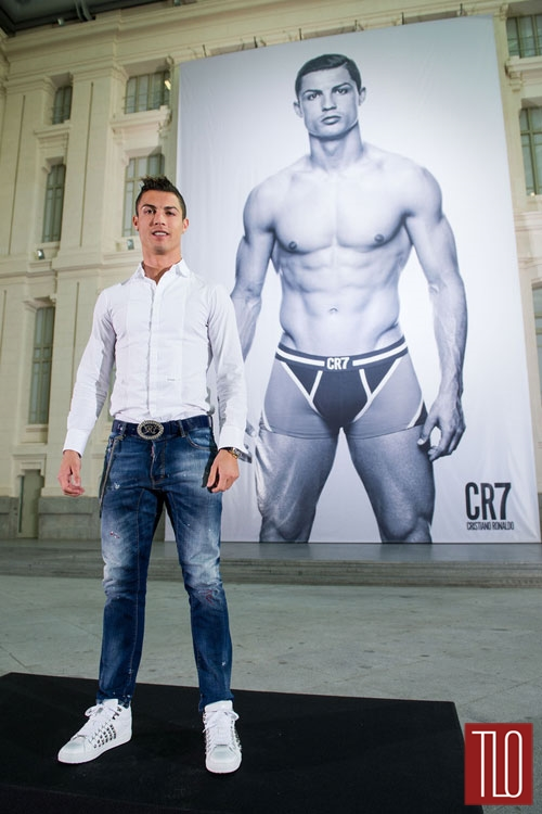 Footballer Cristiano Ronaldo poses in front of a 19m high billboard during the global launch of the CR7 by Cristiano Ronaldo Underwear line at the Palacio de Cibeles in Madrid, Spain. Photo: CR7